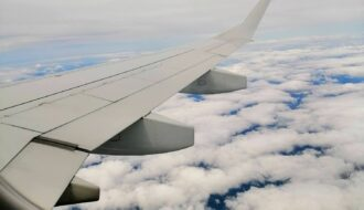 The clouds below the plane wing